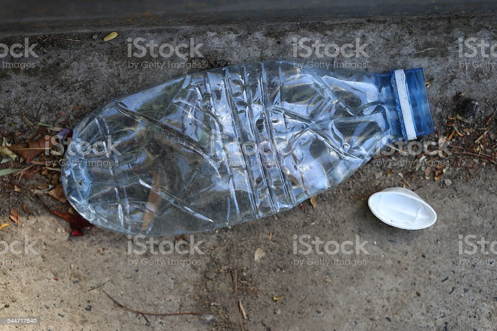 Crushed Plastic Bottle on the Ground stock photo