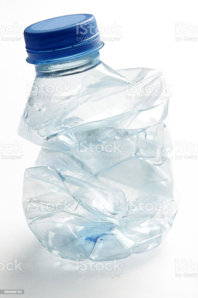 Crushed plastic bottle to recycle stock photo