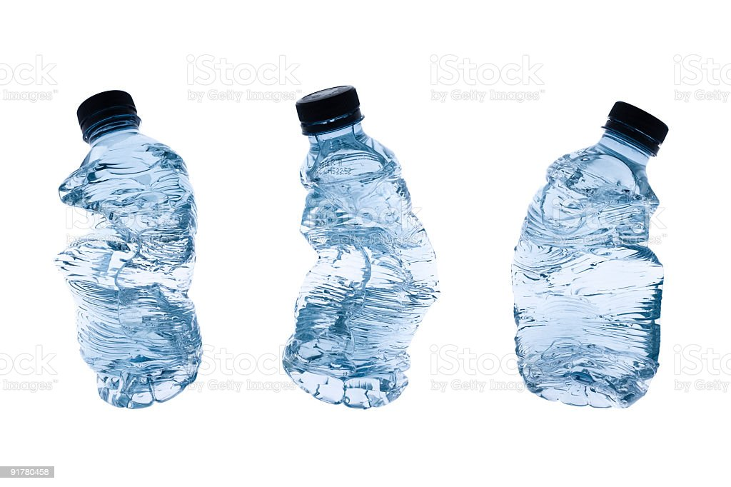 Crushed plastic water bottles isolated on a white background royalty-free stock photo
