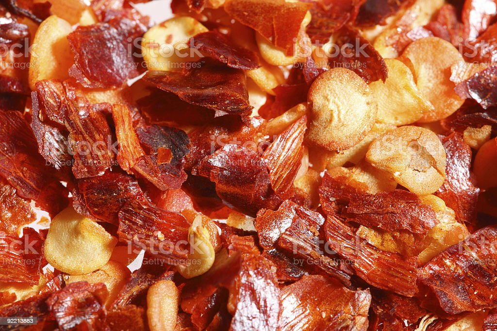 crushed red hot chilli pepper, super macro shot royalty-free stock photo