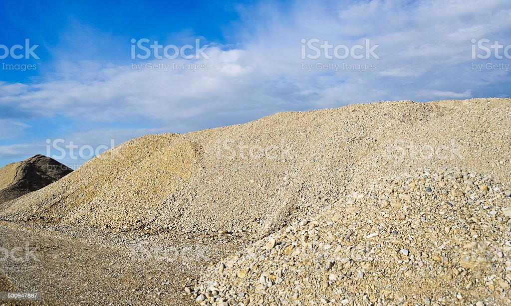 crushed stone and gravel on a construction site stock photo