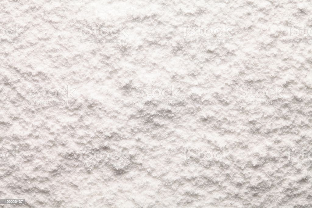 Crushed white sugar spread out on a surface stock photo