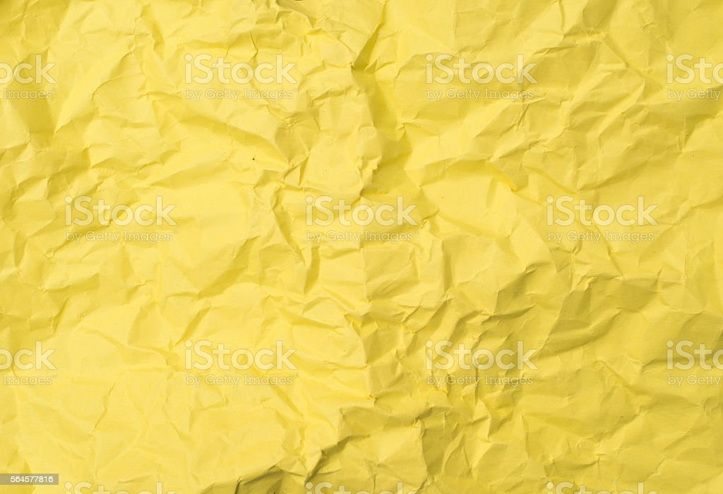 Crushed yellow paper stock photo