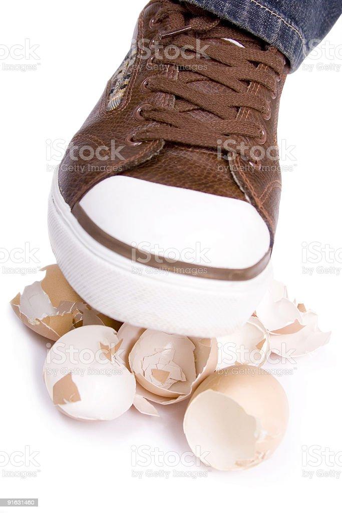 Crushing eggs stock photo