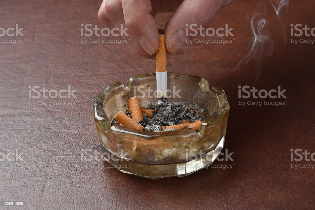 Crushing out a cigarette stock photo