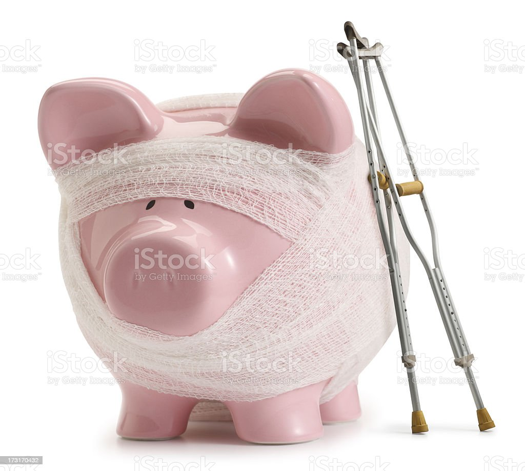 Crutches lean against piggy bank wrapped in gauze stock photo