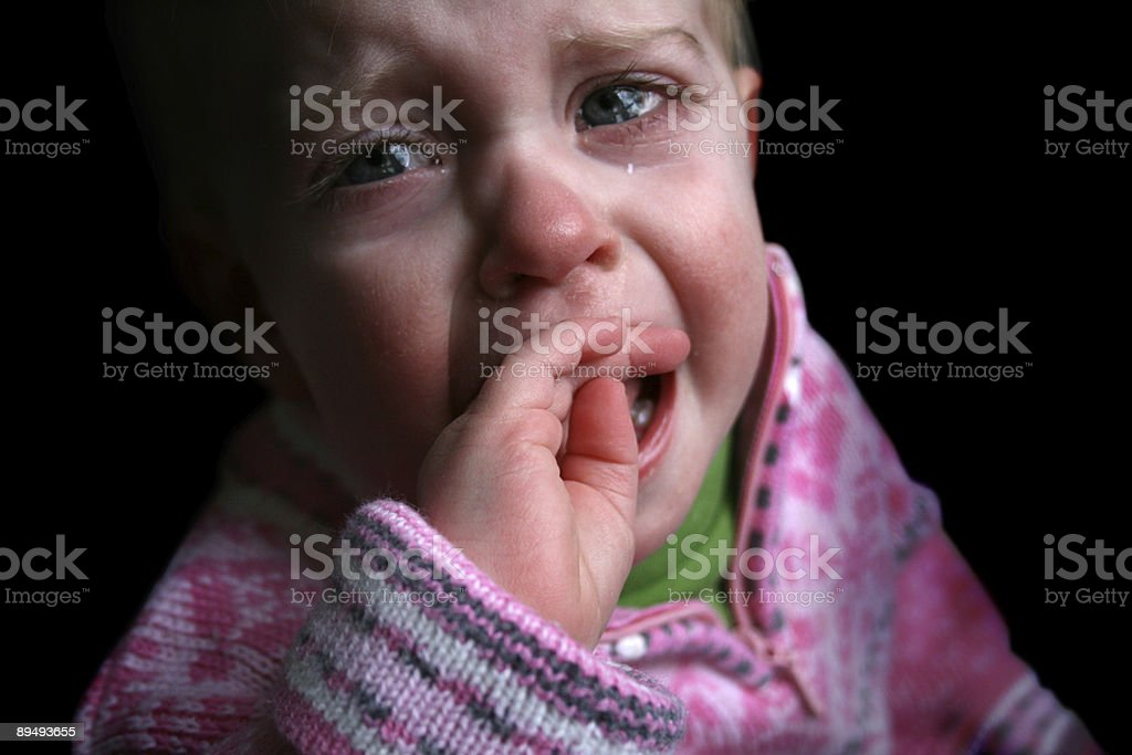Cry Baby: Little Girl in Pink Crying Sadly royalty-free stock photo