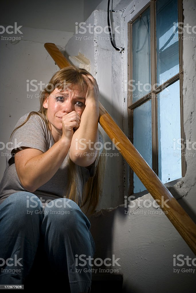 Crying alone in the staircase royalty-free stock photo