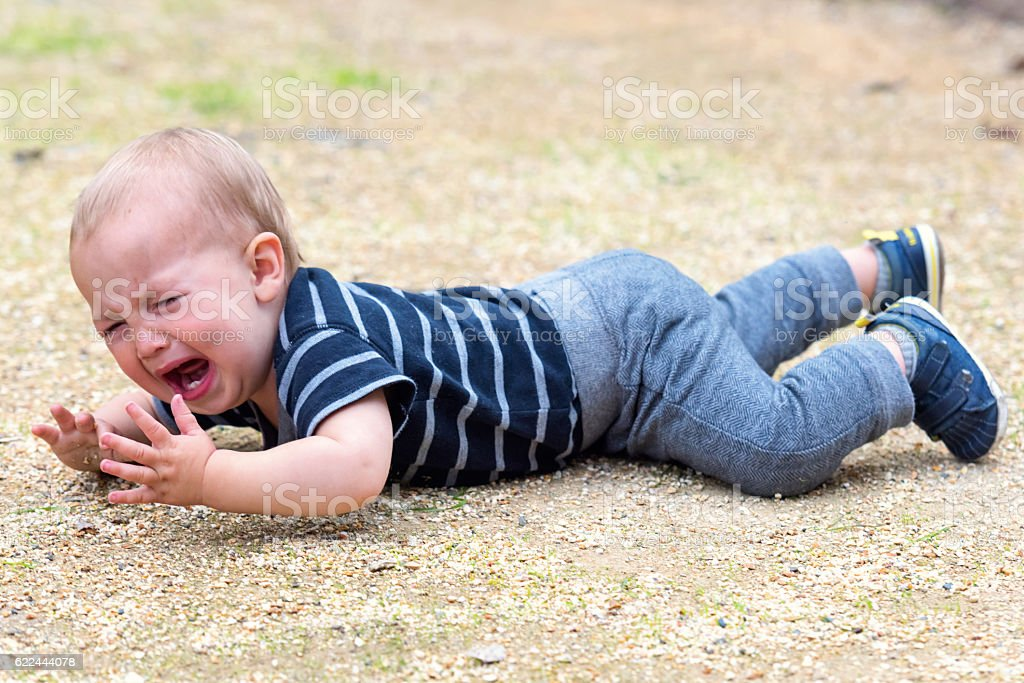 crying baby at the park stock photo