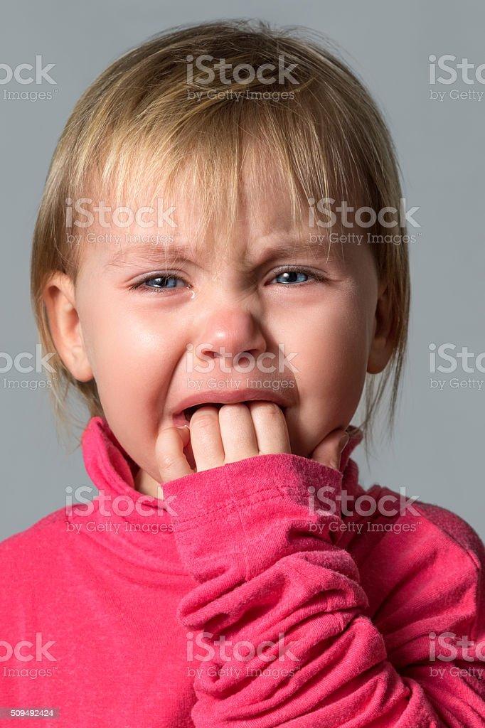 Crying baby girl isolated stock photo