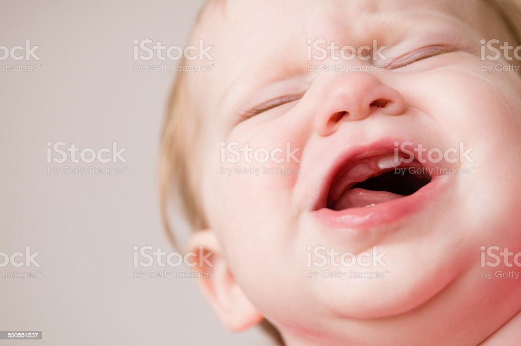 Crying Baby Suffering Through Pain of Teething stock photo