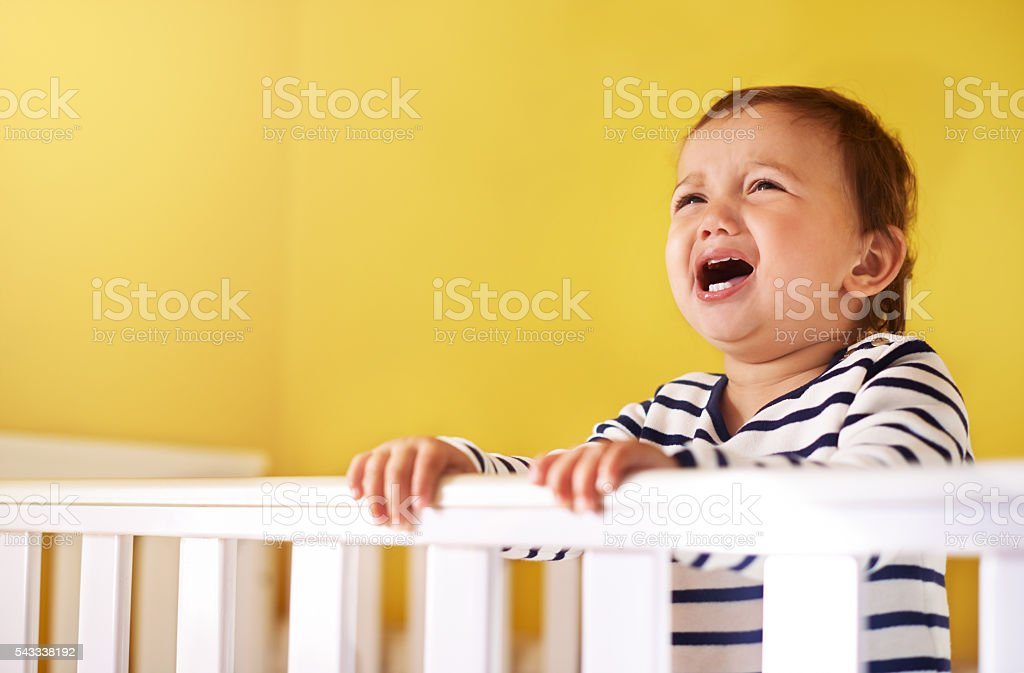 Crying in her cradle stock photo