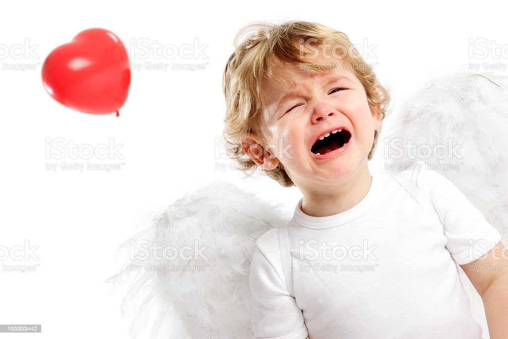 Crying little Angel & Heart shaped balloon; flying away royalty-free stock photo