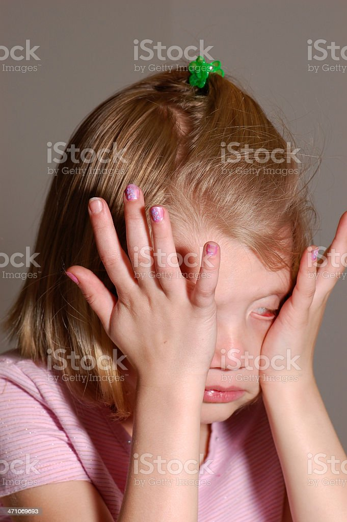 Crying Little Girl Rubbing Eyes royalty-free stock photo