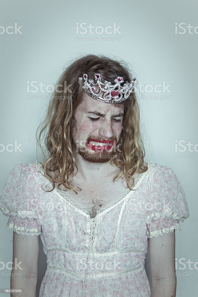 Crying Male Prom queen in drag tiara on head lipstick stock photo