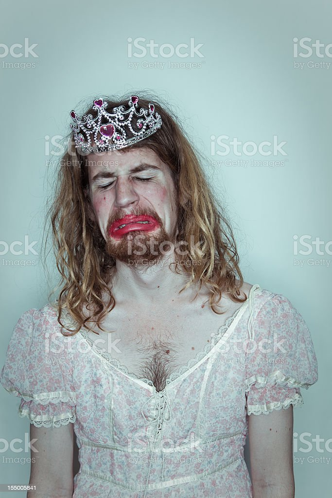 Crying man homecoming queen in drag tiara on head lipstick stock photo