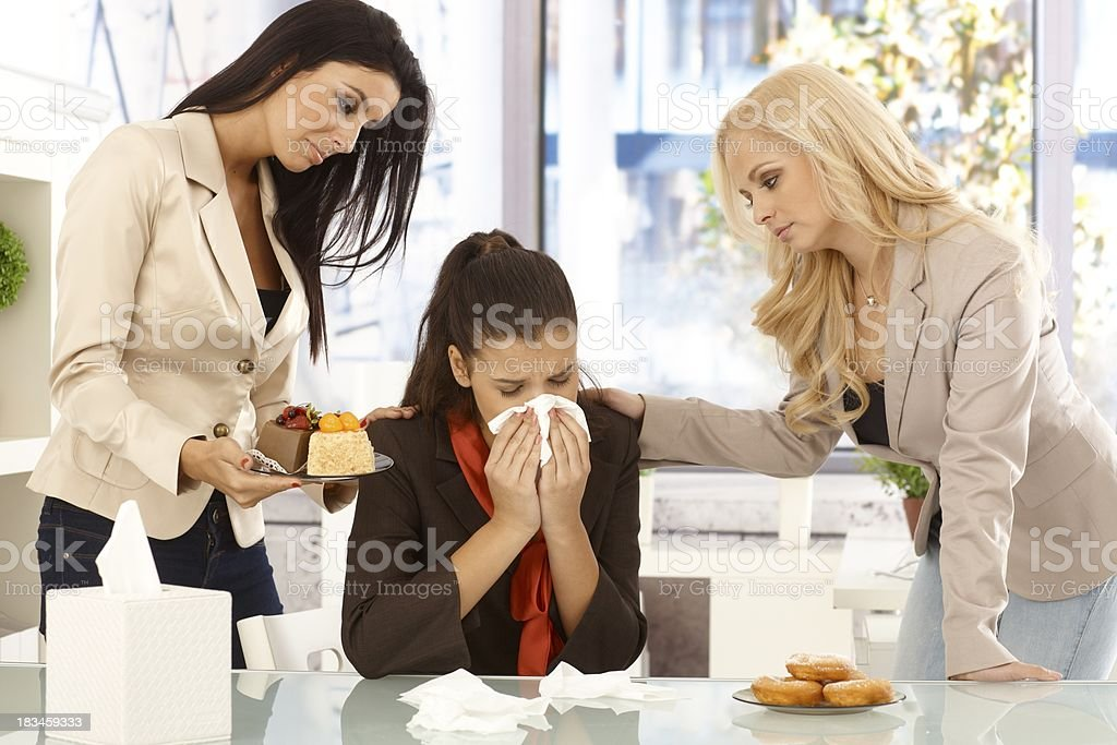 Crying office worker comforted by colleagues royalty-free stock photo