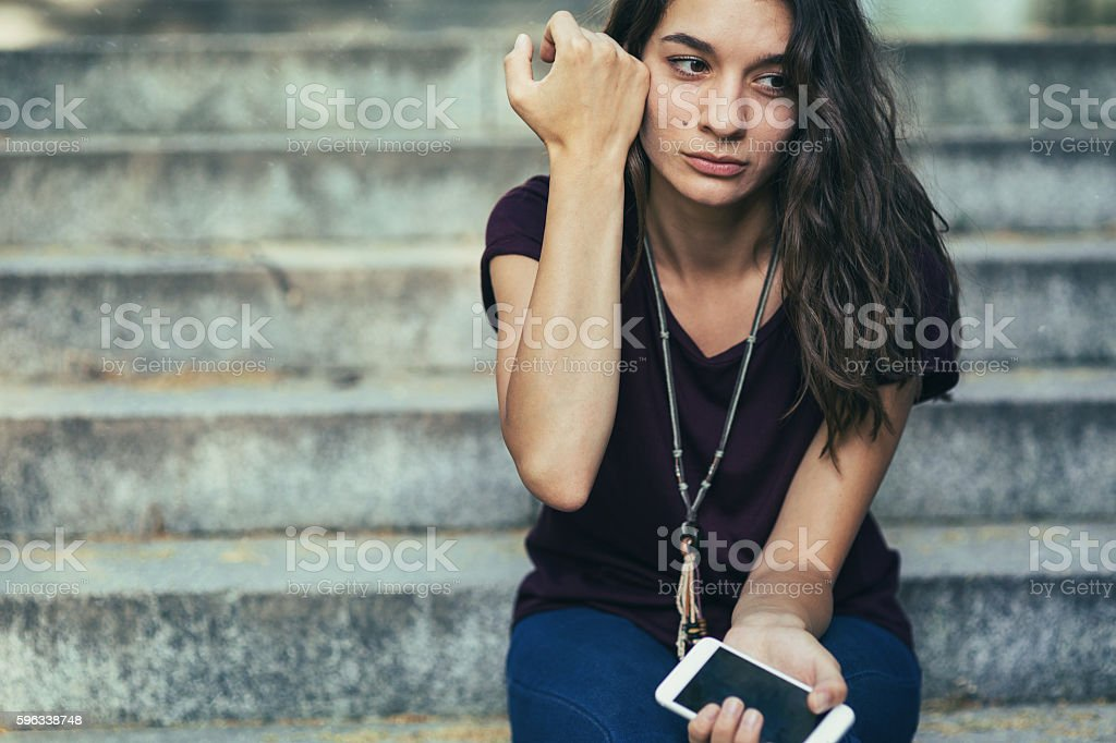 Crying on the stairs stock photo
