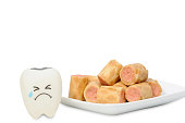Crying rubber teeth with crispy snack, Healthcare concept