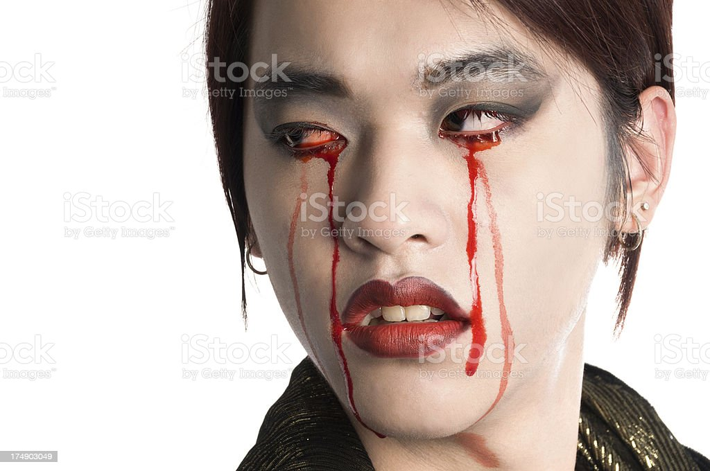 Crying vampire looking back over shoulder. royalty-free stock photo