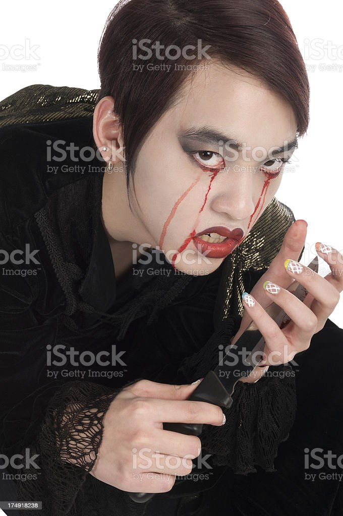 Crying vampire looking up from cutting hand royalty-free stock photo