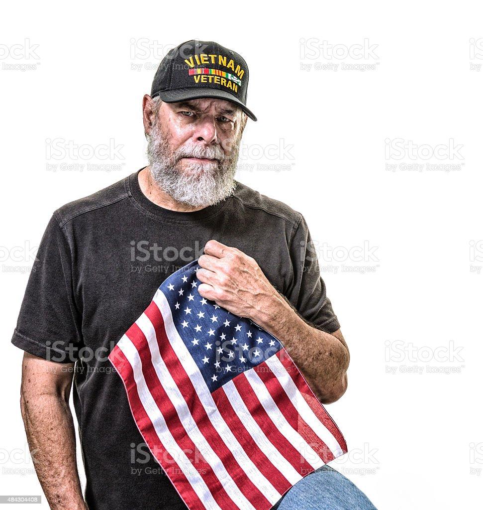 Crying Vietnam Veteran Holding American Flag stock photo