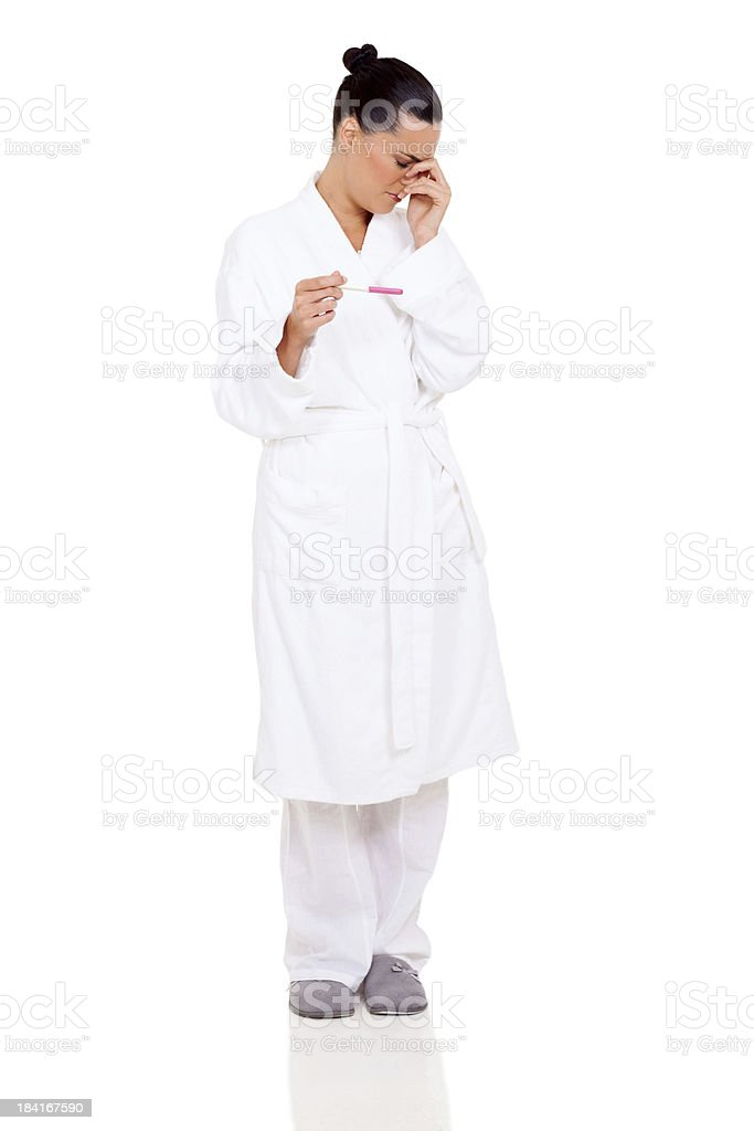 crying woman holding a pregnancy test royalty-free stock photo
