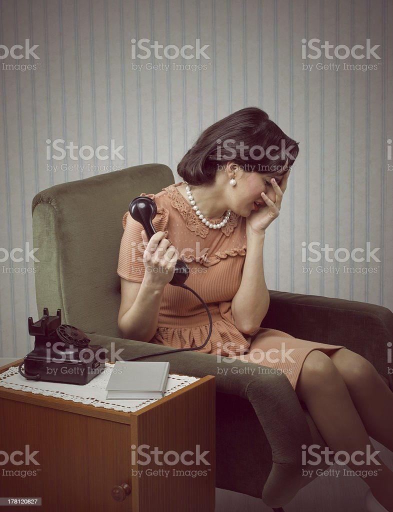 Crying woman receives a bad news royalty-free stock photo