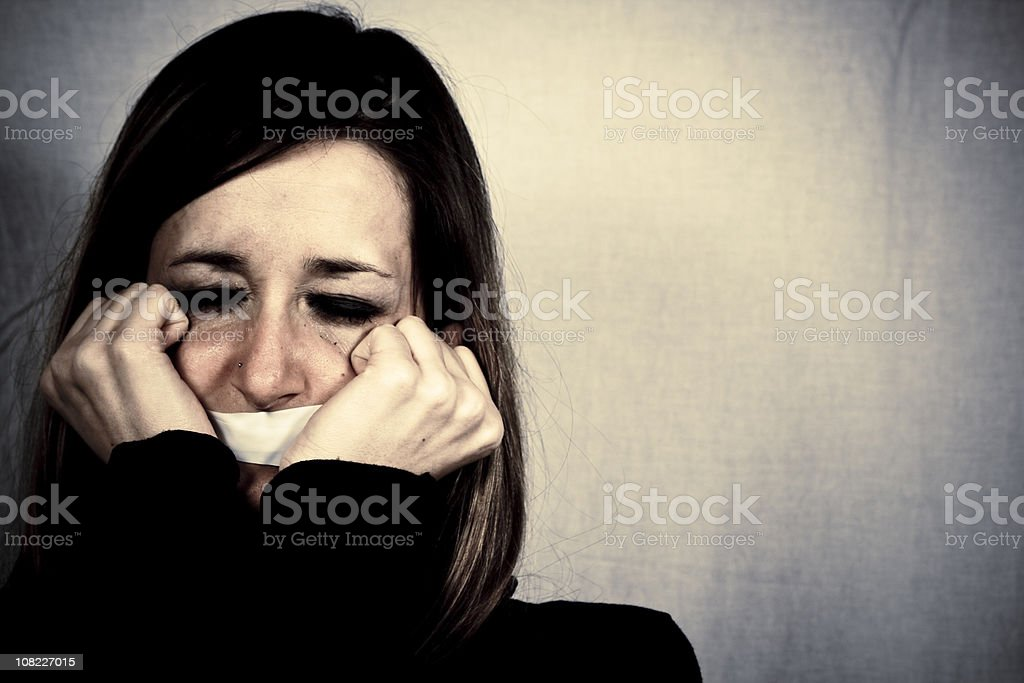 Crying Woman with Tape Covering Mouth royalty-free stock photo