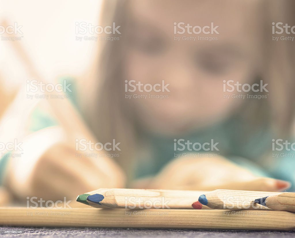 Cryons with Sketching Girl stock photo