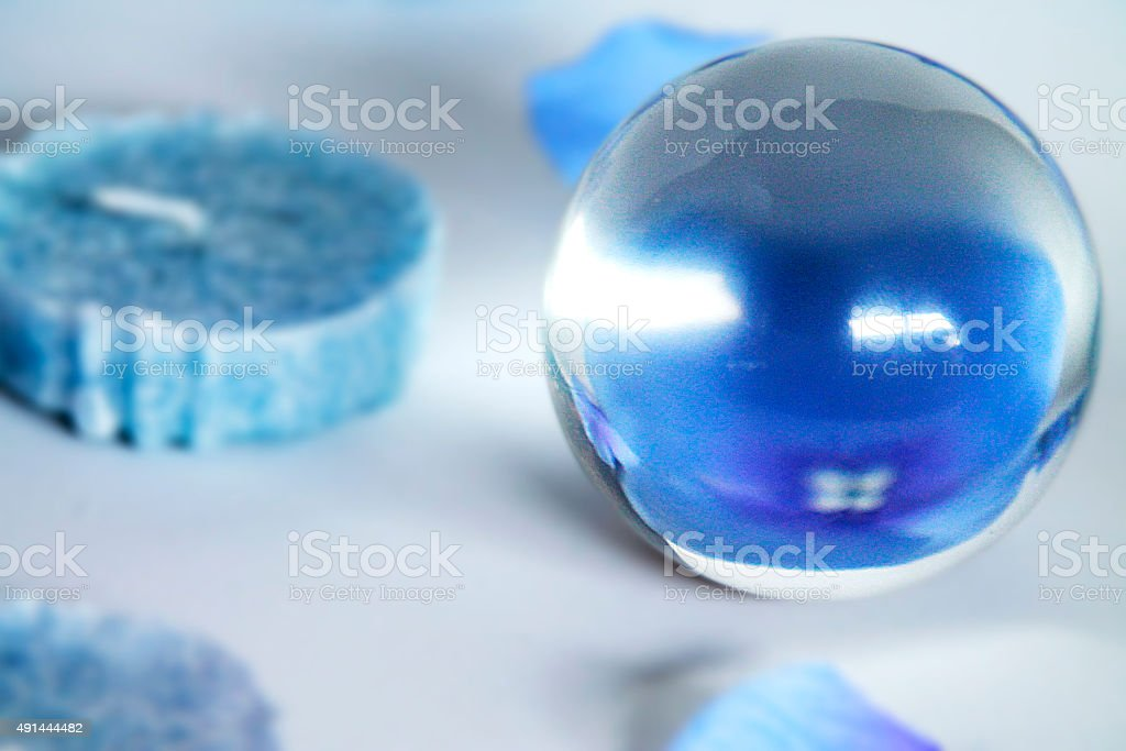 Crystal ball and blue candles stock photo