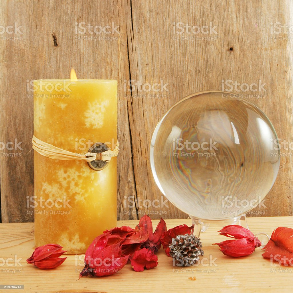 Crystal ball and candle stock photo