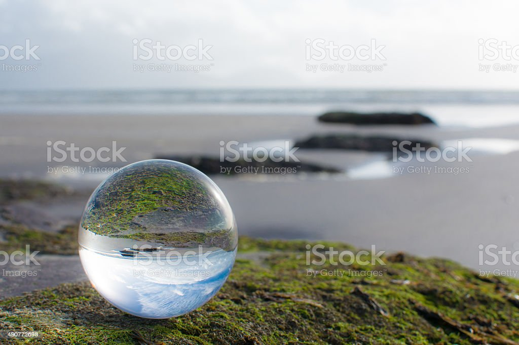 Crystal ball at the beach stock photo