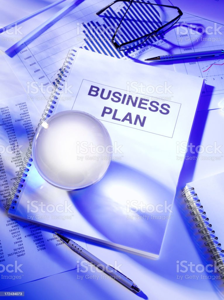 Crystal Ball on a Business Plan in the Office royalty-free stock photo