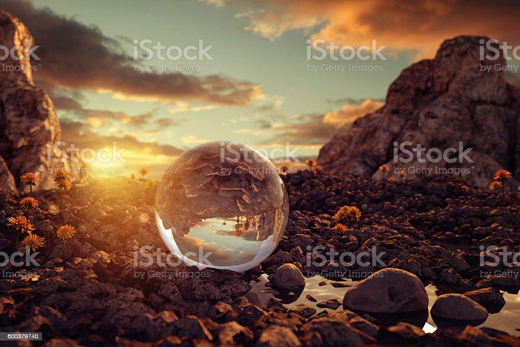 crystal ball on rocky terrain in the evening sunlight stock photo