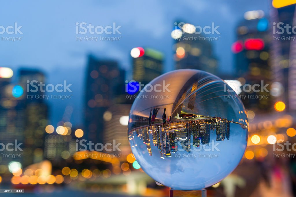 Crystal Ball with Reflection of Singapore CBD Skyline stock photo