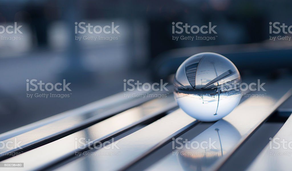 Crystal ball with reflection on city stock photo