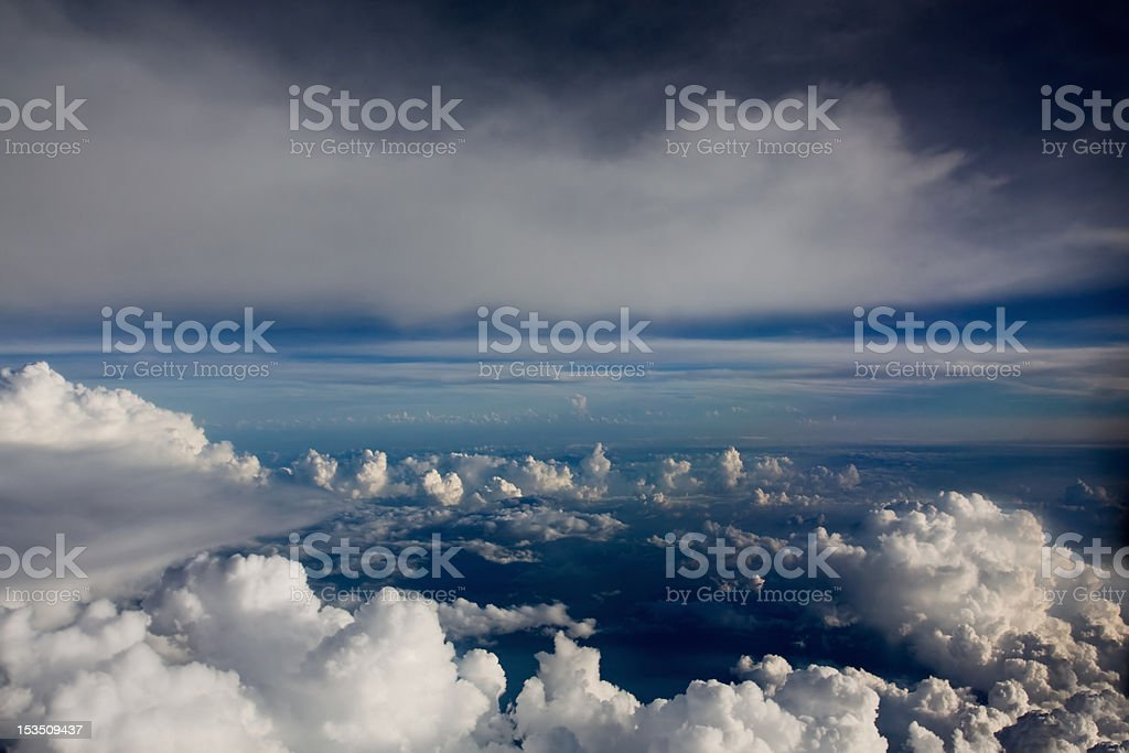 Crystal blue sky above clouds stock photo