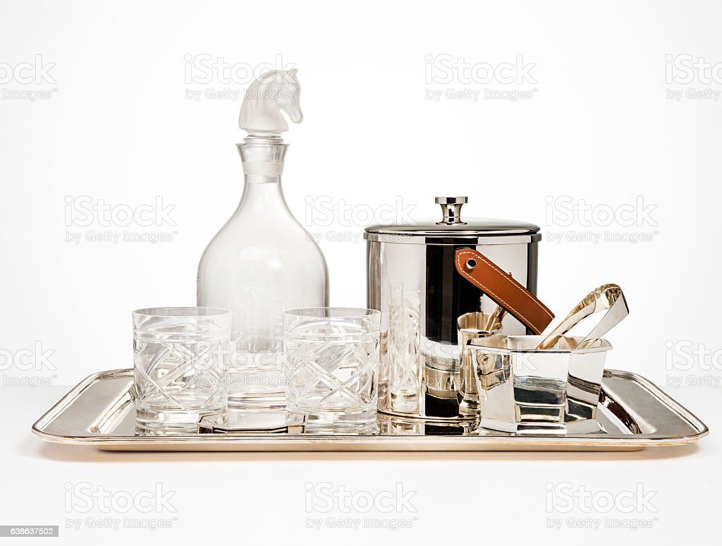 Crystal Carafe ,two glasses and silver icebox on silver tray stock photo