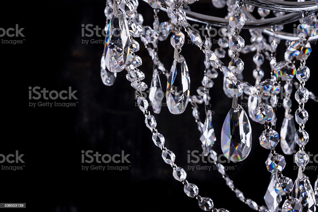 Crystal chandelier close-up on black stock photo