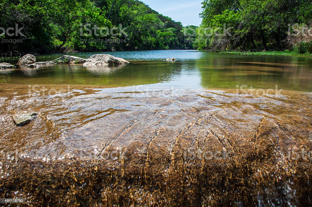 Crystal Clear Running Water Greenbelt Austin Texas Summertime Fun stock photo