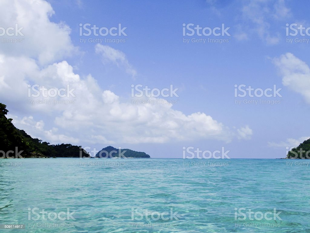 Crystal clear sea water against blue sky in Phanga, Thailand stock photo