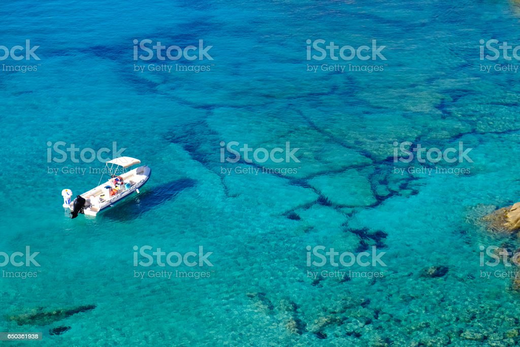 Crystal Clear Water and Boat, Sardinia stock photo