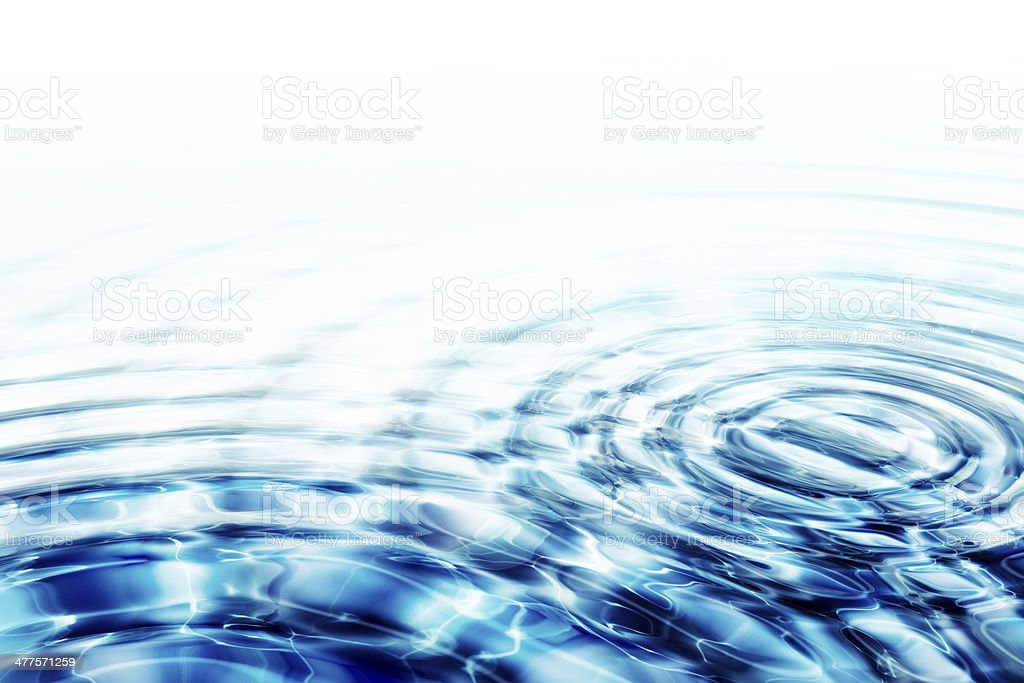 crystal clear water whit two ripples stock photo