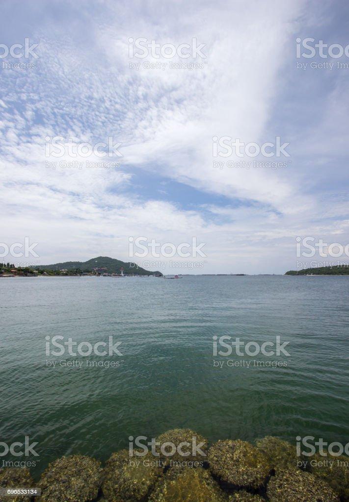 crystal clear water with beautiful sky,Asadang Bridge ,Koh Sichang stock photo