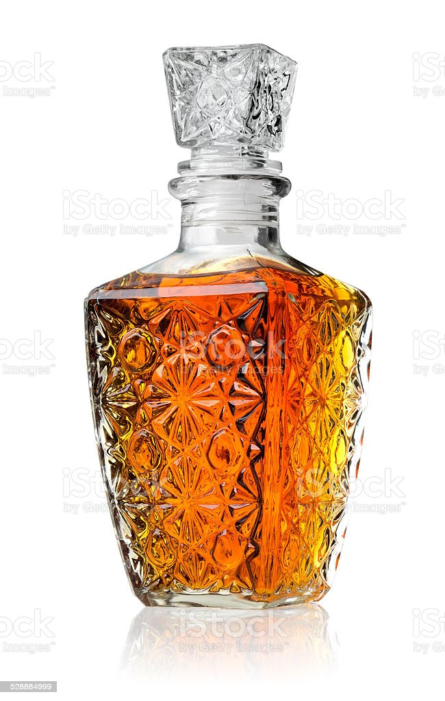 Crystal decanter with cognac stock photo
