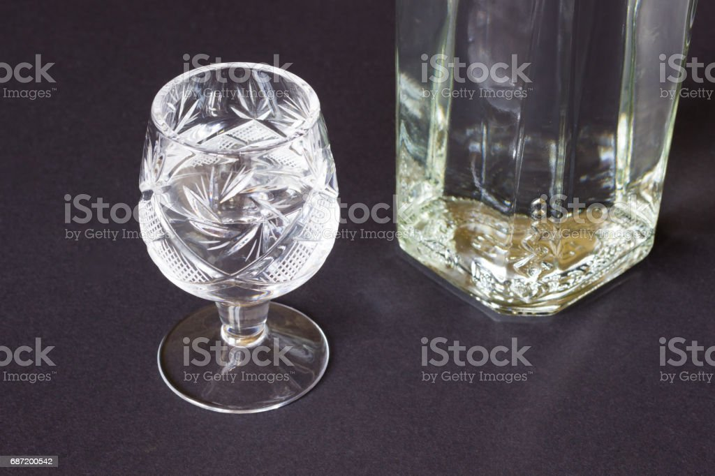 Crystal glass and the bottle on a dark background stock photo