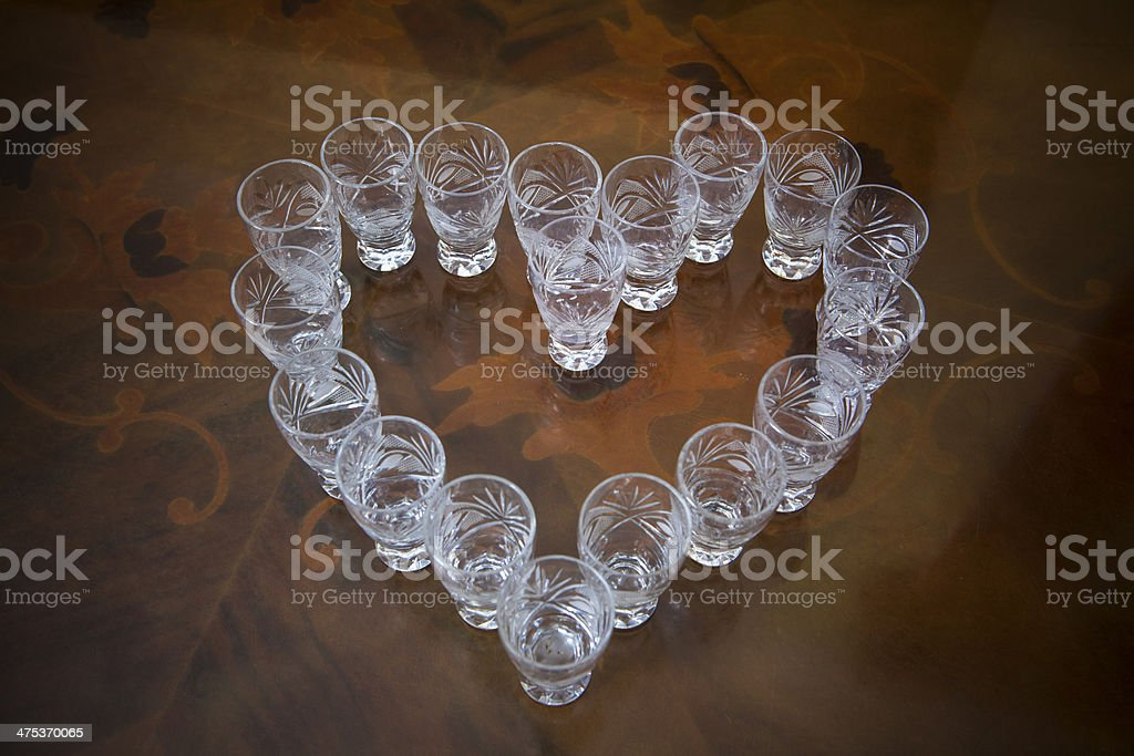 Crystal glasses arranged in the shape of a heart royalty-free stock photo
