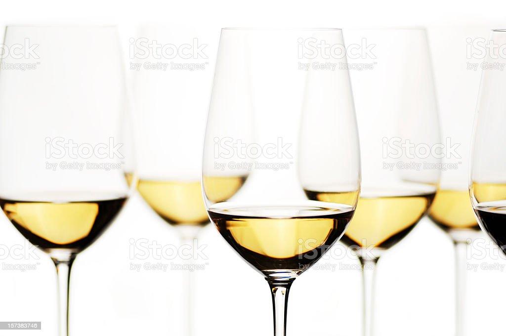Crystal glasses of white wine on white background stock photo