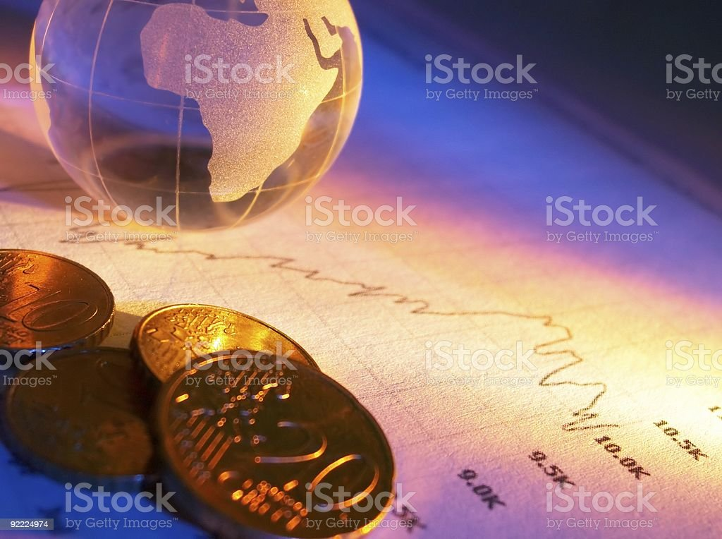 Crystal globe coins and stock chart royalty-free stock photo